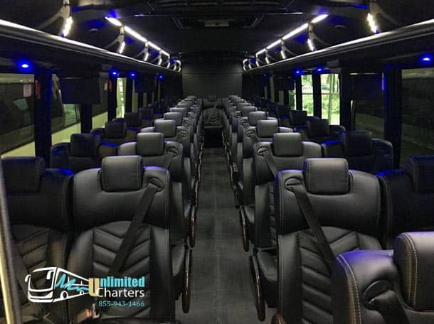 61 passenger coach bus - charter bus - Unlimited Charters - in